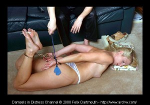 Nikita toe-tied in a handcuff-leg iron hogtie