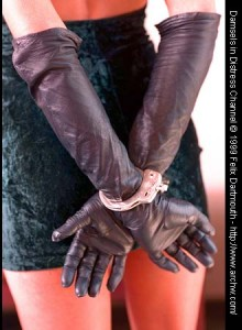 A Slut in Handcuffs at a formal event
