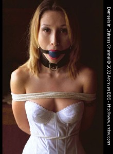 Erica collared, ball-gagged and tied up in bridal slip
