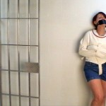 Amber lockup - straitjacketed in a penis gag
