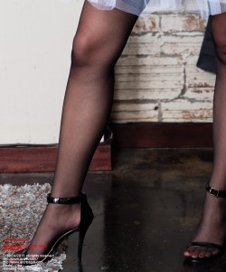 All prisoners sold as slaves are required to wear strap-on high heels