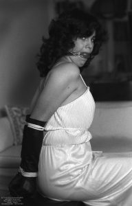 Really pretty model who was a secretary in an office I visited - her elbows easily touched and she brought her high-school prom gown - she was astonished at her ball-gag! Circa 1981. Only black and white photos exist - there is some color video converted from Super 8.