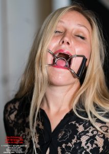 Despite keeping up a brave appearance, Brianne Blu at times can be overcome with the gravity of her situation, as she sits handcuffed and gagged with a metal intruding spider-gag!