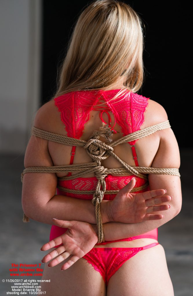 The Prisoner 7 - Brianne Blue is tightly tied up in jute in inappropriate lingerie