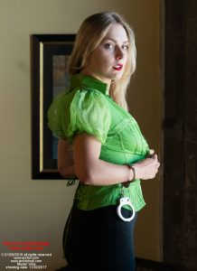 Vika in Cruel Bondage - Vika dresses for lunch, wearing a Bebe top, and handcuffs on her wrists