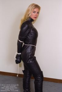 Sherry Catwoman outfit, tied at wrists and elbows with crotch-rope