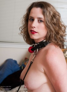 Collared and leashed with ball-gag ready