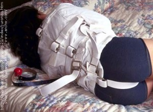 Gwen strapped in a freshly laundered and starched straitjacket