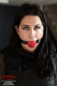 Tilly, female slave, is tightly ball-gagged!
