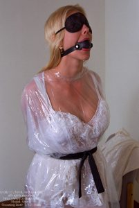 Sherry - lingerie, plastic poncho, gagged and blindfolded