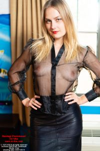 The Prisoner Vika in sheer black blouse, leather skirt