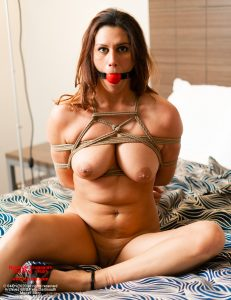 Mary, during bondage transport training, is ball-gagged and tied up in a Japanese takate kote